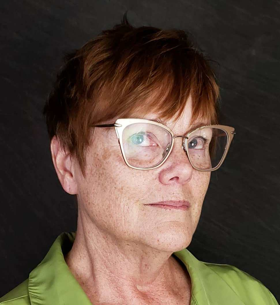 Very Short Haircut for Women Over 60 with Glasses
