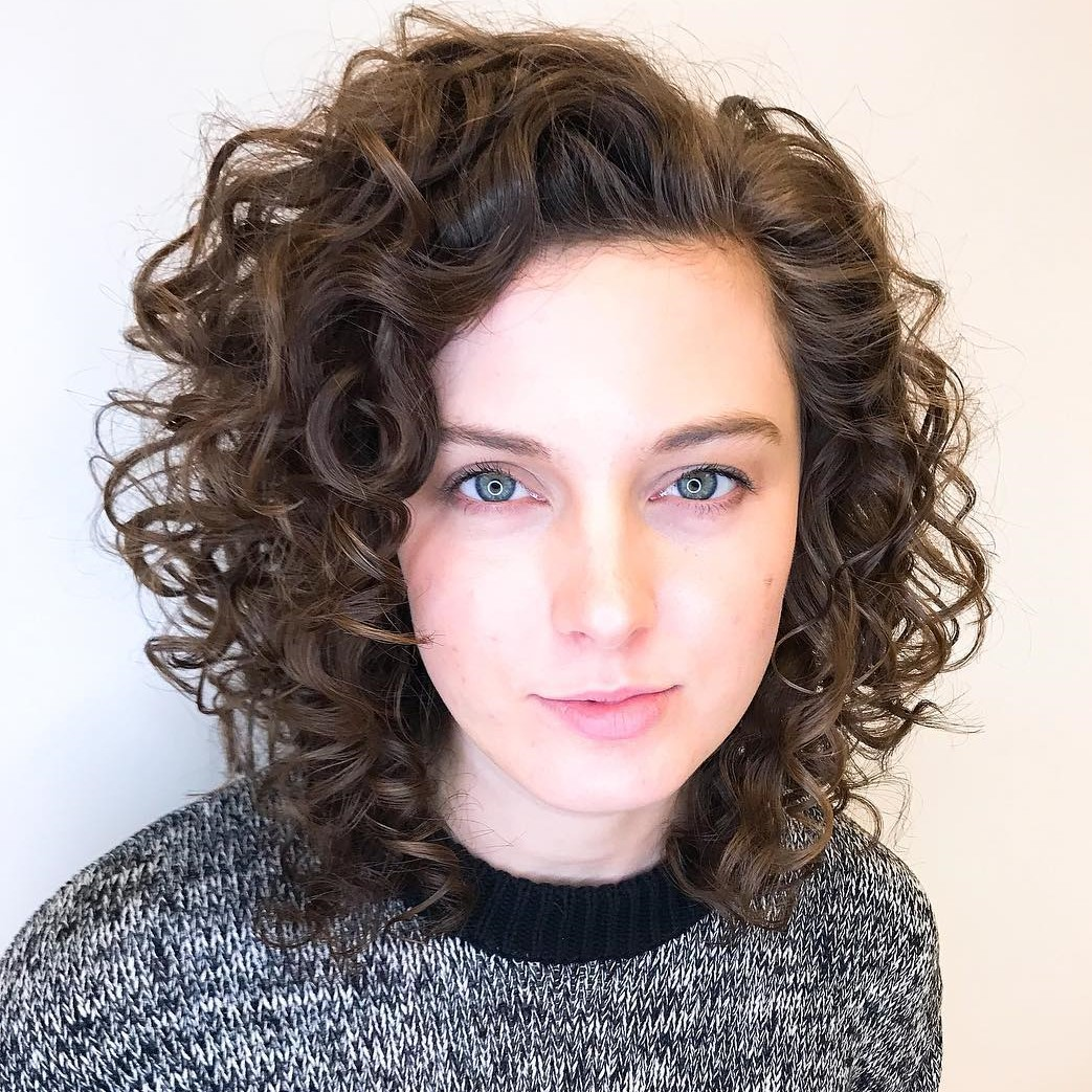 Medium Layered Curls for Oval Faced Women
