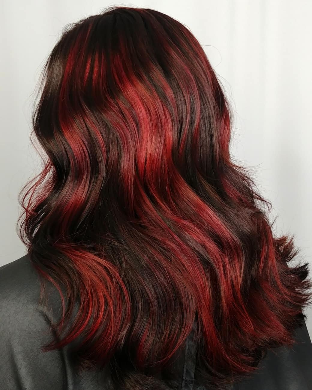 Elegant Dark Hair with Red Highlights