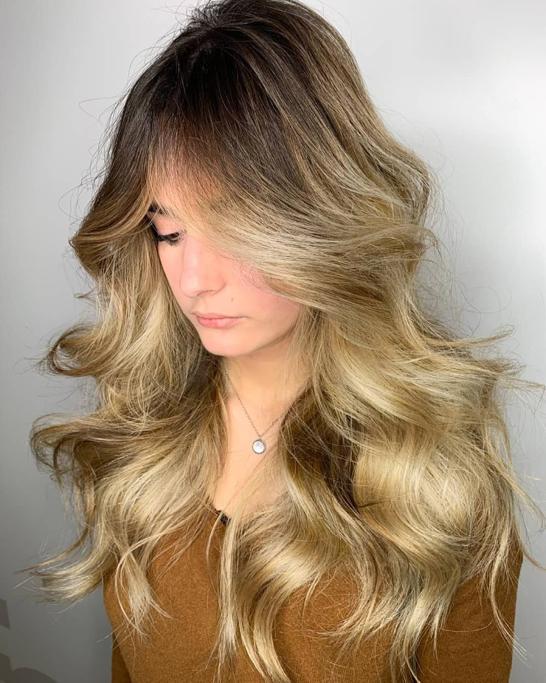 Dark Roots and Golden Blonde Lengths