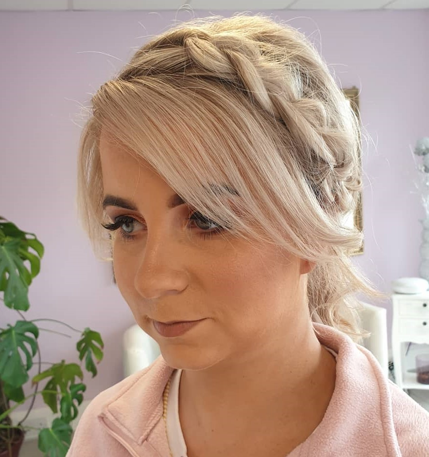 Messy Braided Updo for Women with Bangs