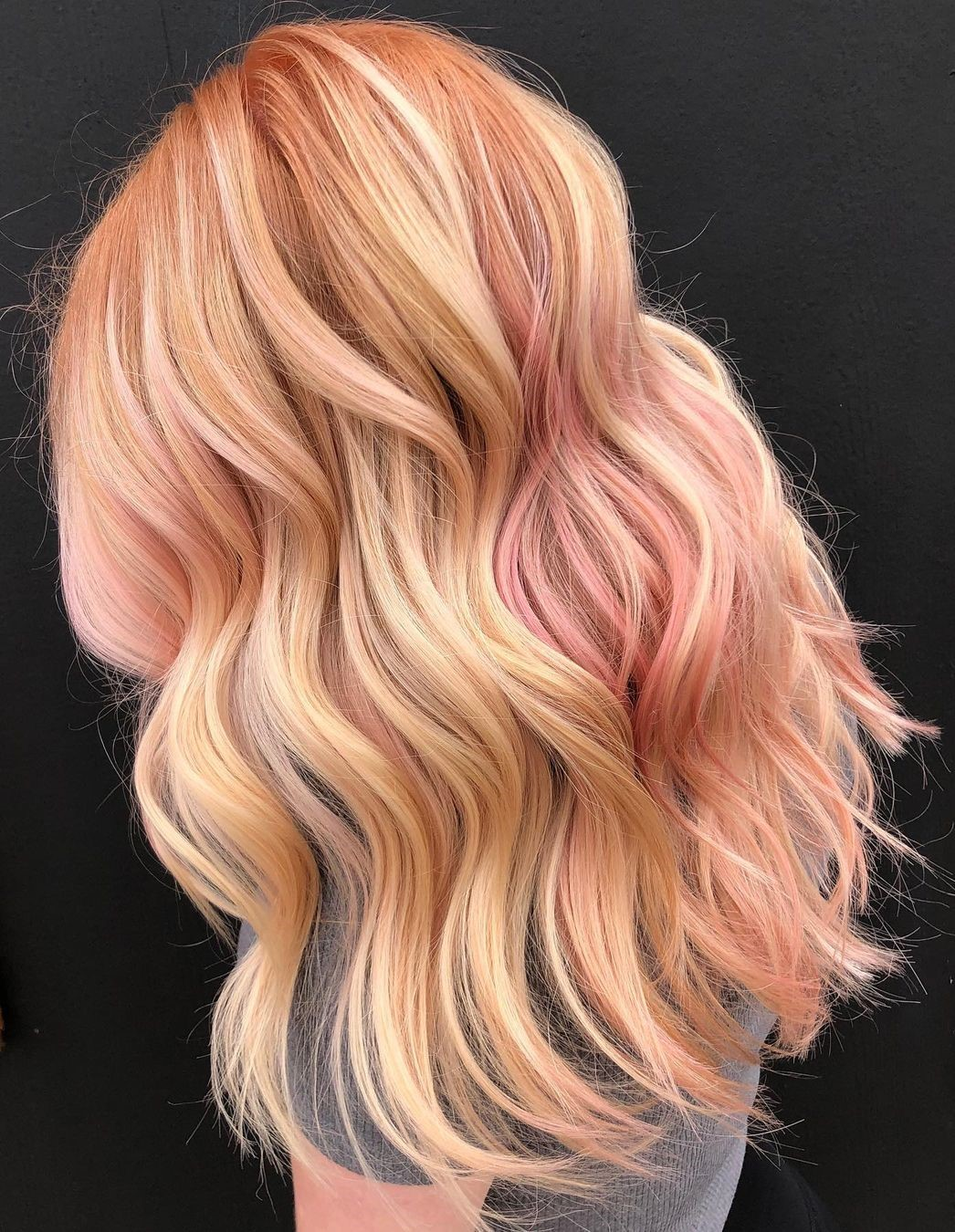 Long Blonde Hair with Rose Gold Highlights