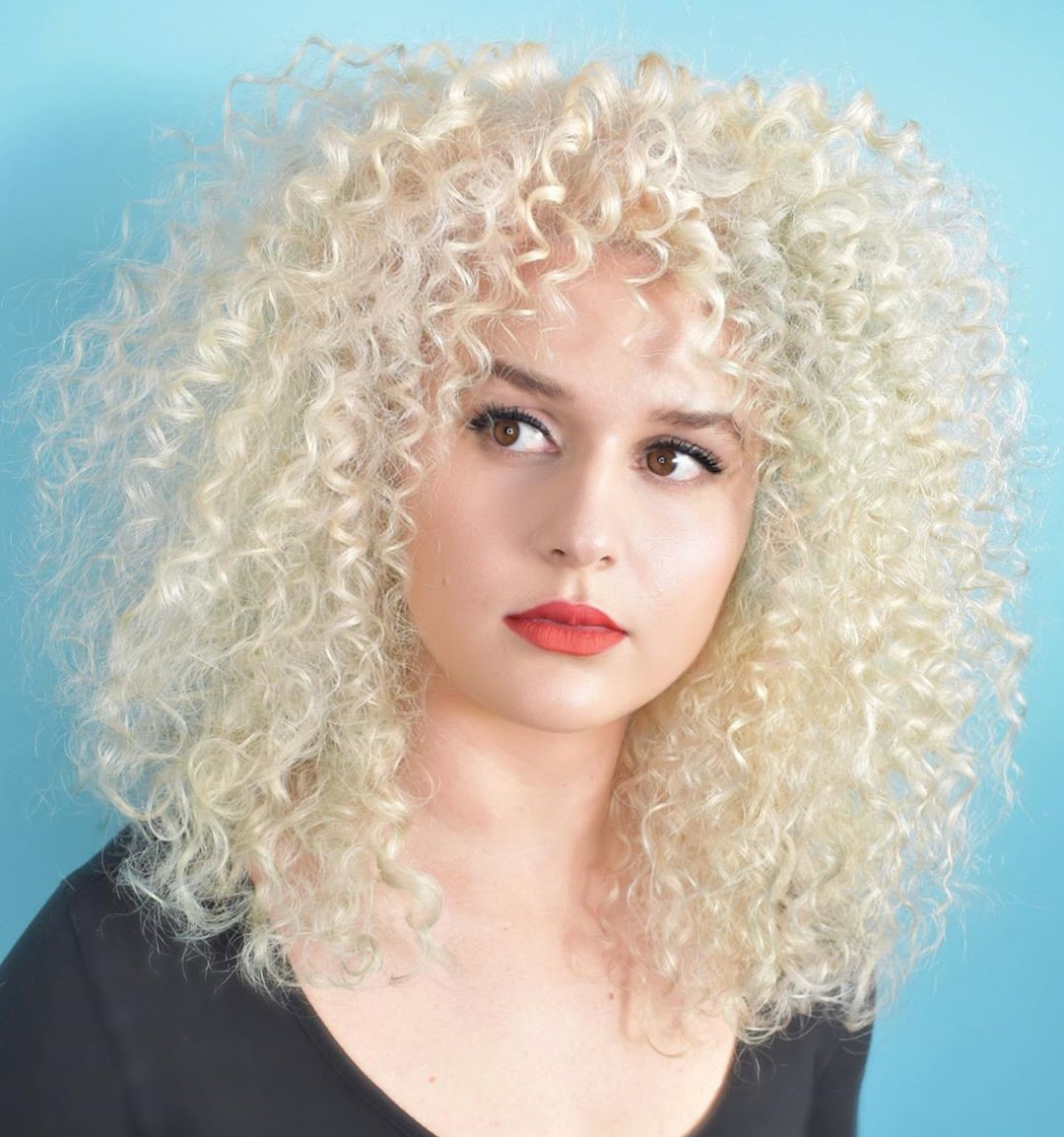 Medium Curly Platinum Blonde Hairstyle