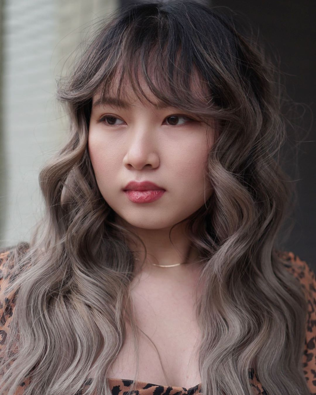 Long Wavy Hair with Bangs for a Round Face