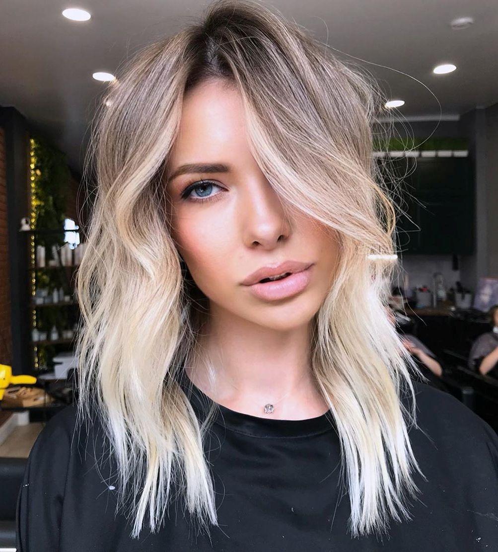 Platinum Blonde Highlights and Dark Roots