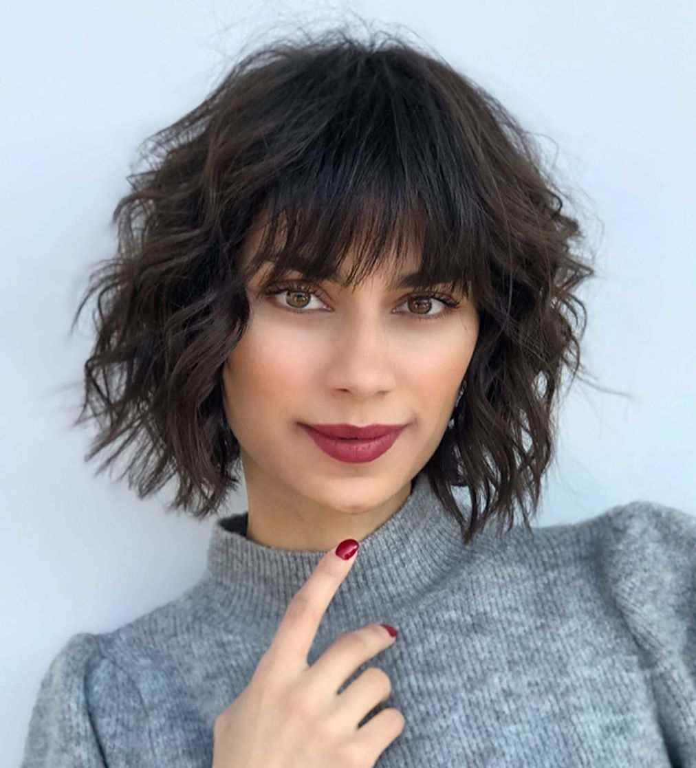 Layered Bob with Bangs for Wavy Hair