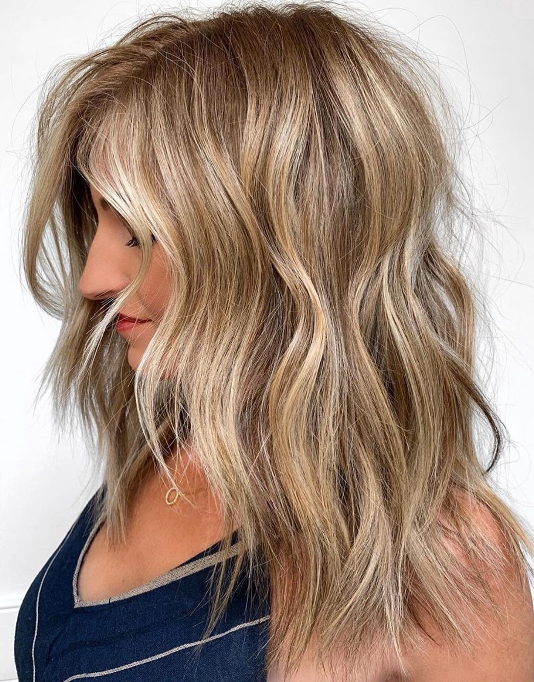 Dirty Blonde Hair with Sun-Kissed Highlights