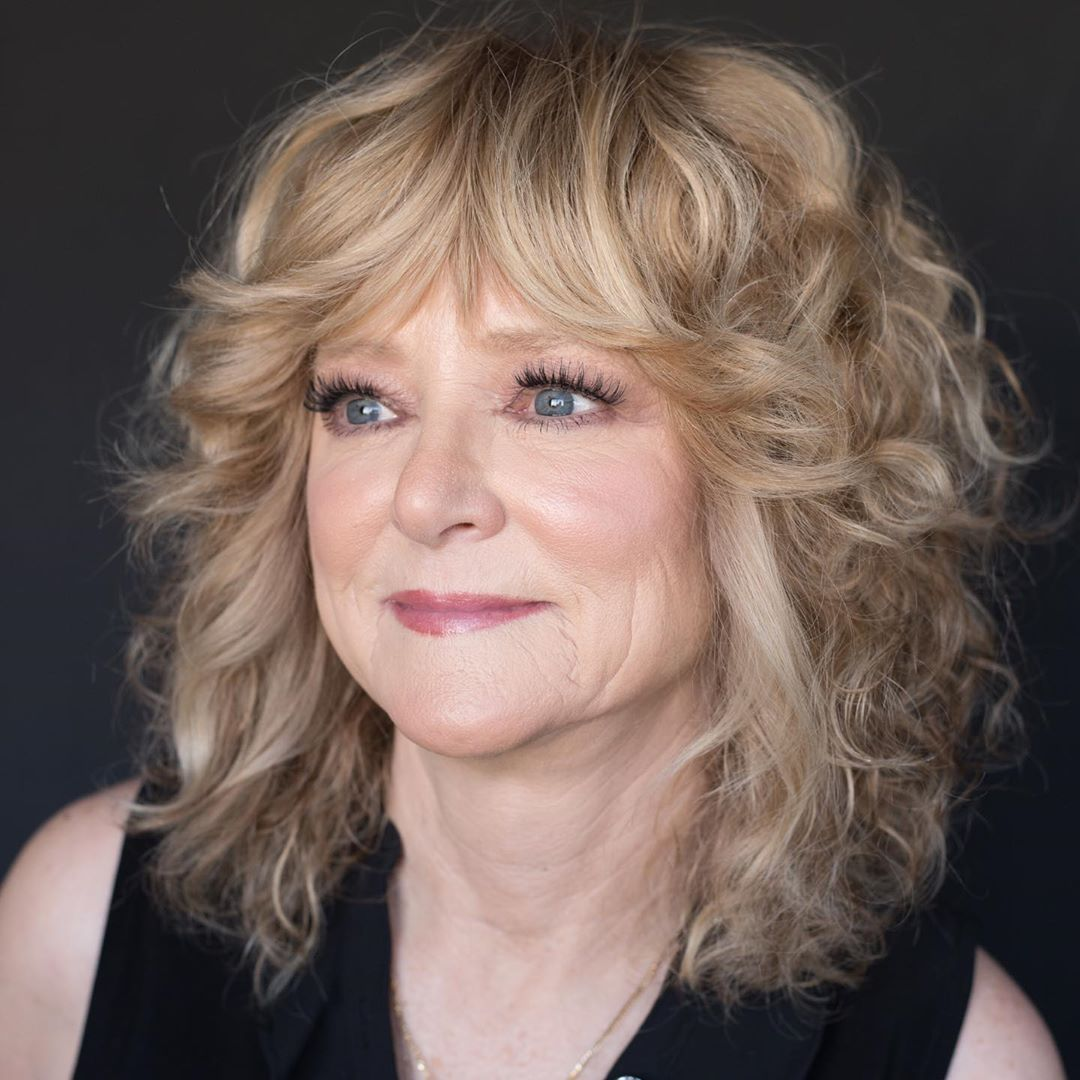 Over 50 Curly Medium Haircut with Bangs
