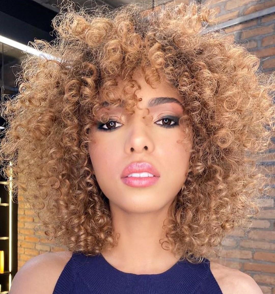Medium Natural Layered Hairstyle with Bangs