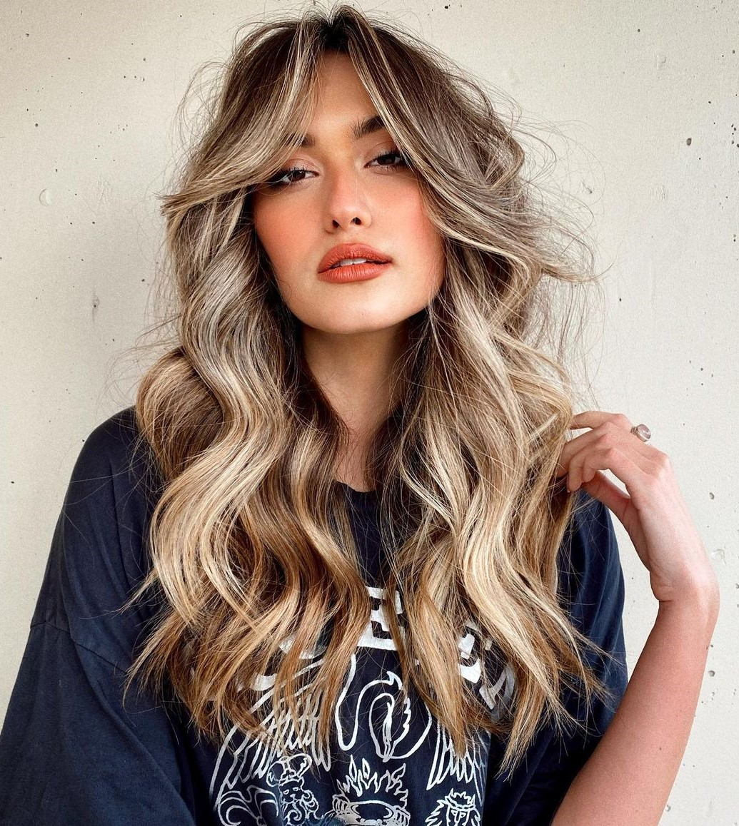 Long Hair with Waves and Curtain Bangs