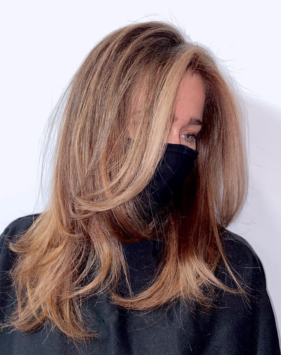 Sun-Kissed Long Choppy Layered Hairstyle