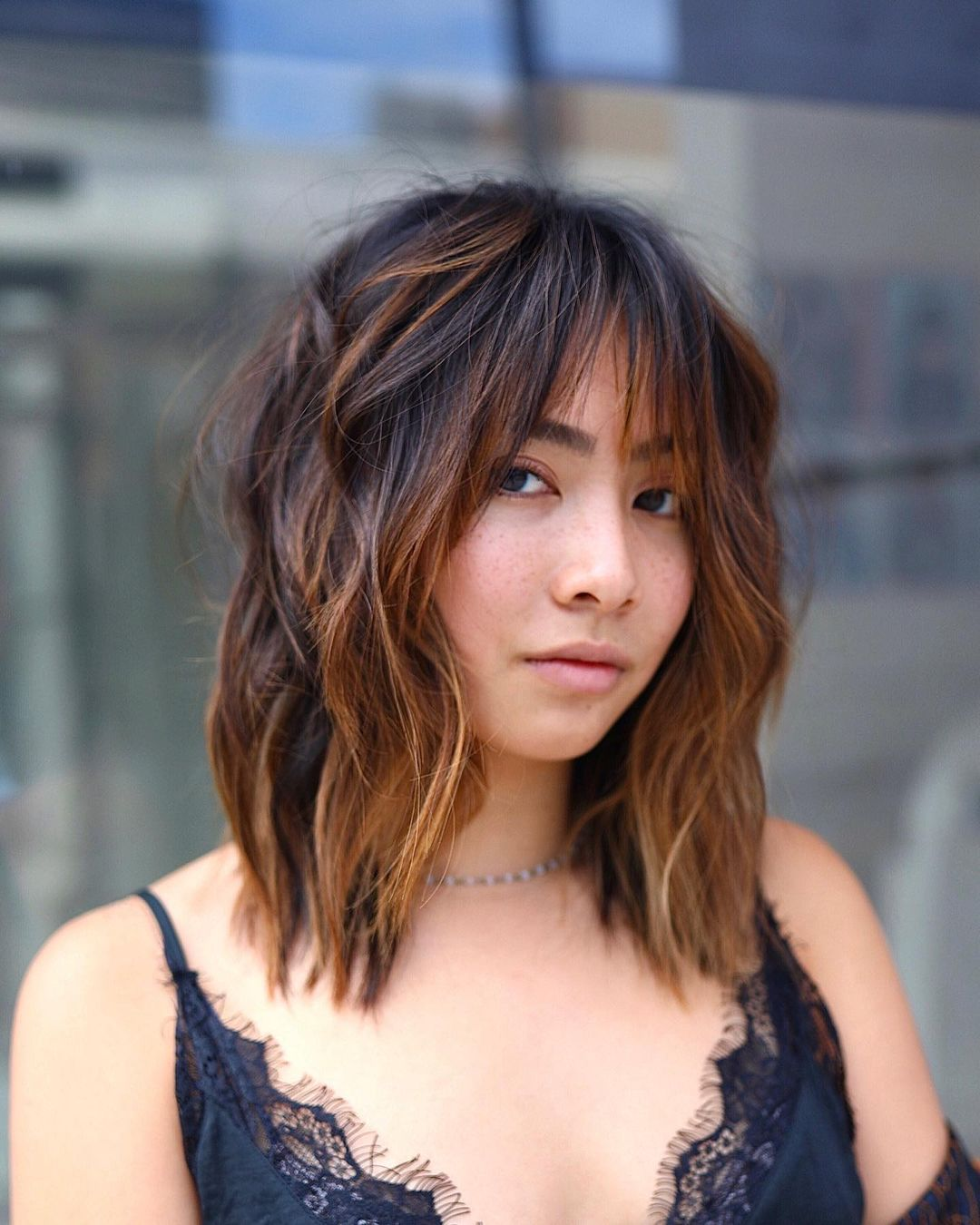 Arched Choppy Bangs for a Round Face Shape