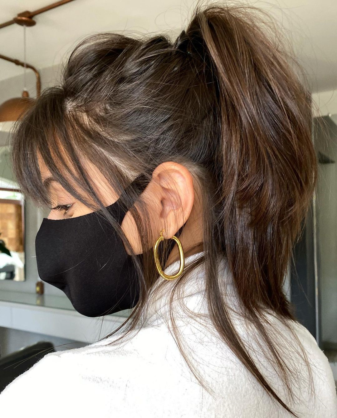 Messy Wispy Ponytail with a Side Fringe