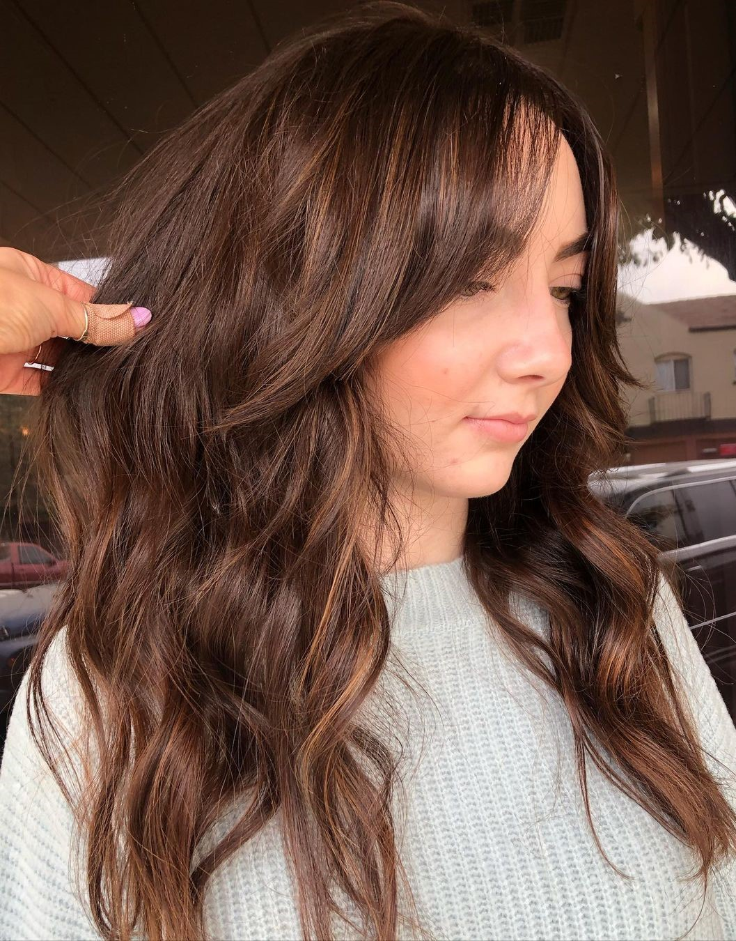Long Wavy Hair with Curtain Bangs