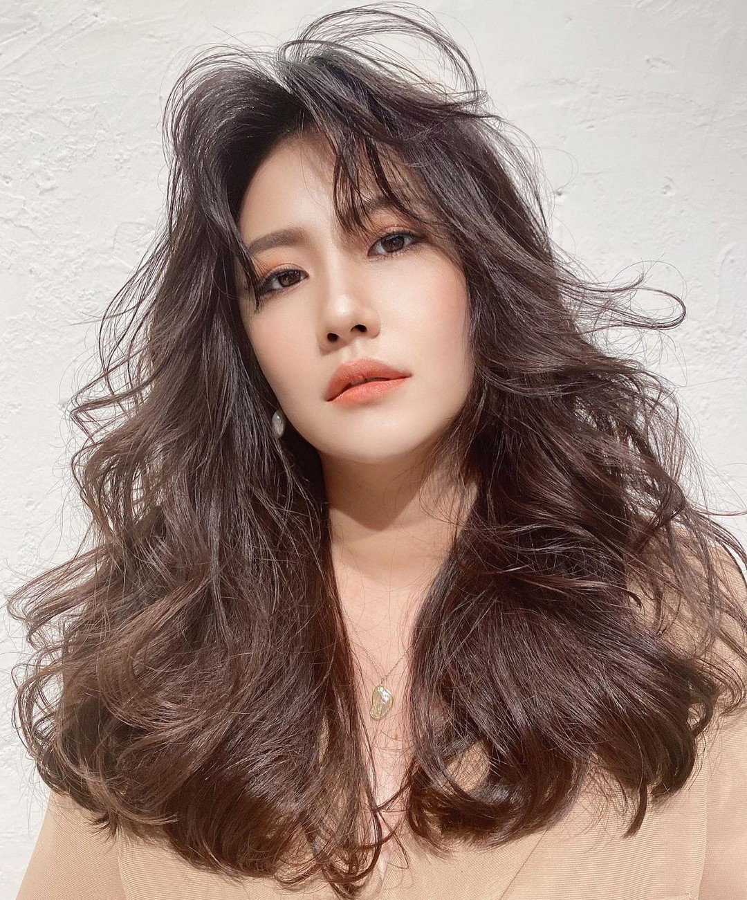 Long Messy Haircut with Chinese Bangs