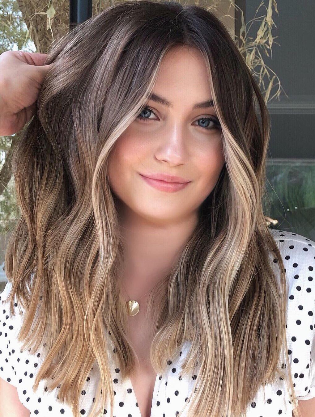 Dark Hairstyle with Golden Highlights