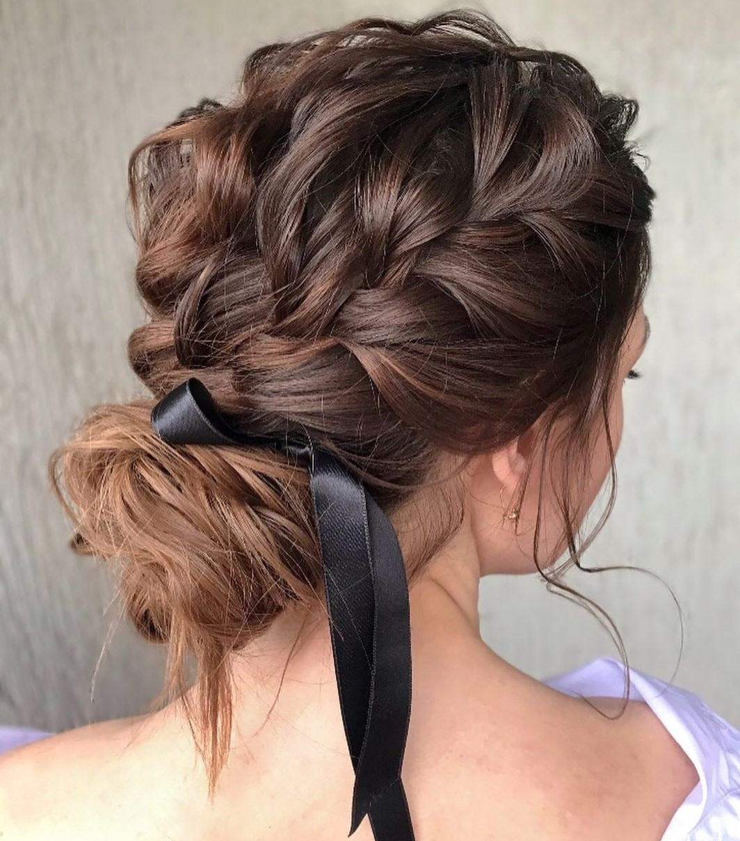 Loose Bun with a Braid and Ribbon