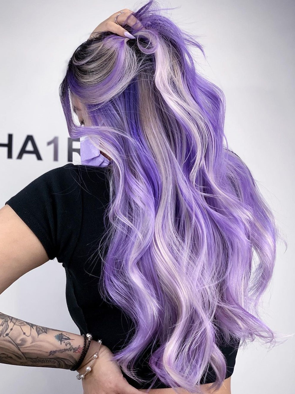 Foxy Blonde and Purple Highlights