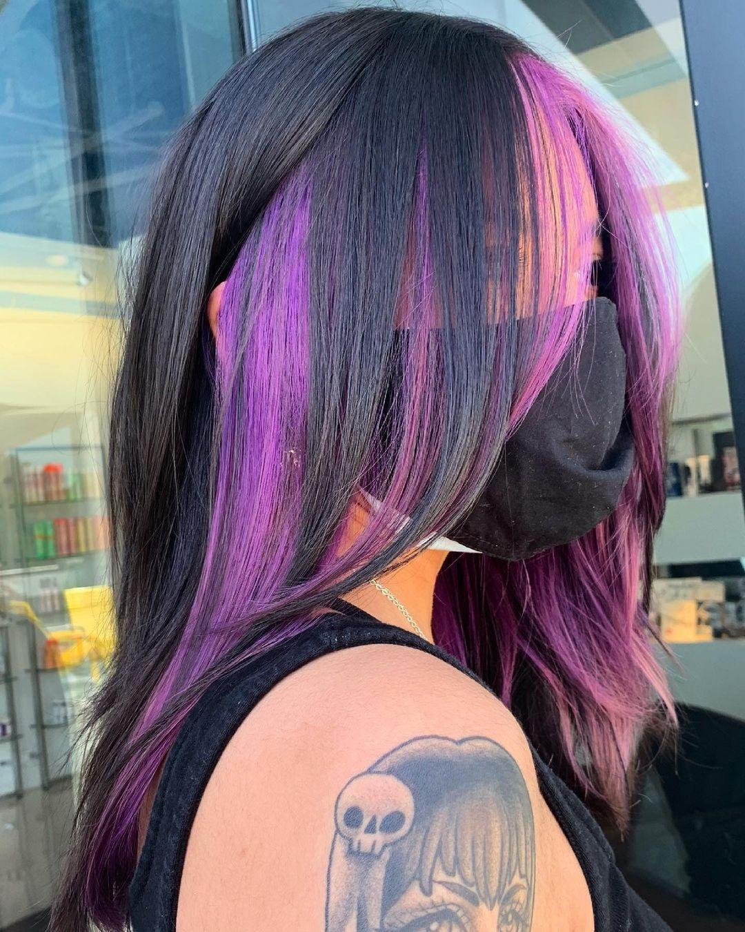Layered Haircut with Purple Peekaboo Highlights