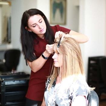 Trichotillomania client having hair system applied