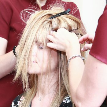 Close up on blonde female with Trichotillomania having wefts attached