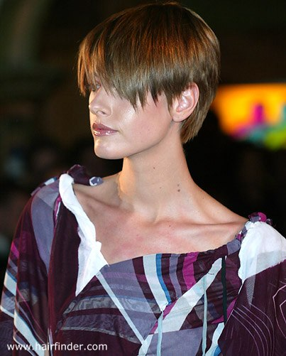 Modern pixie hair cut with bangs layered in the back and blunt cut at the nape