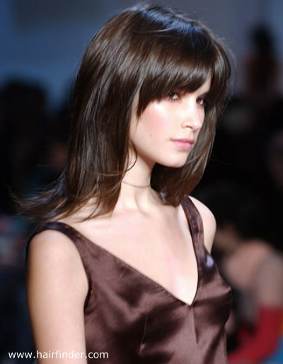 Long hairstyle with a thick fringe to draw attention to