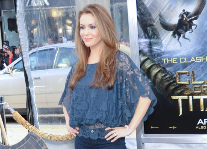 Alyssa Milano wearing her long hair smoothed and below her