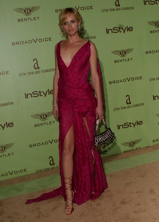 Amber Valletta  Short festive hairstyle with curls in the