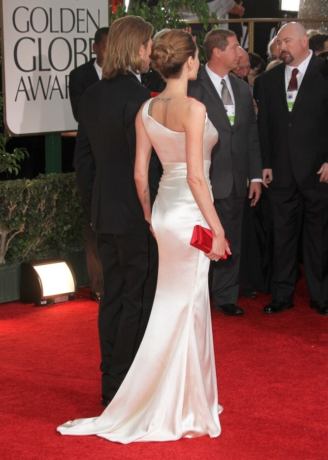 Angelina Jolies hair styled into a simple and elegant updo with a bun