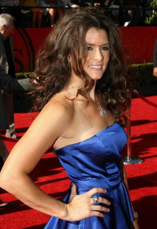 Danica Patrick wearing her long brown hair in curls and parted in the middle