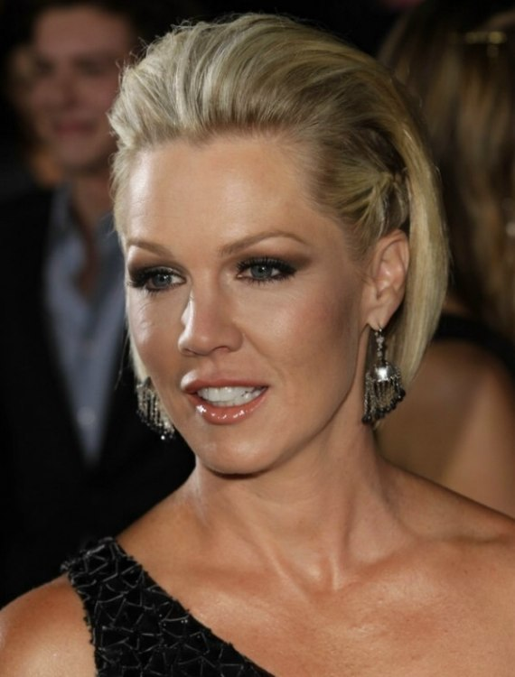 Jennie Garth wearing her short hair with the sides braided close to her head
