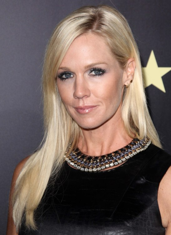 Jennie Garth  At age 40 with long stylish hair tucked behind one ear