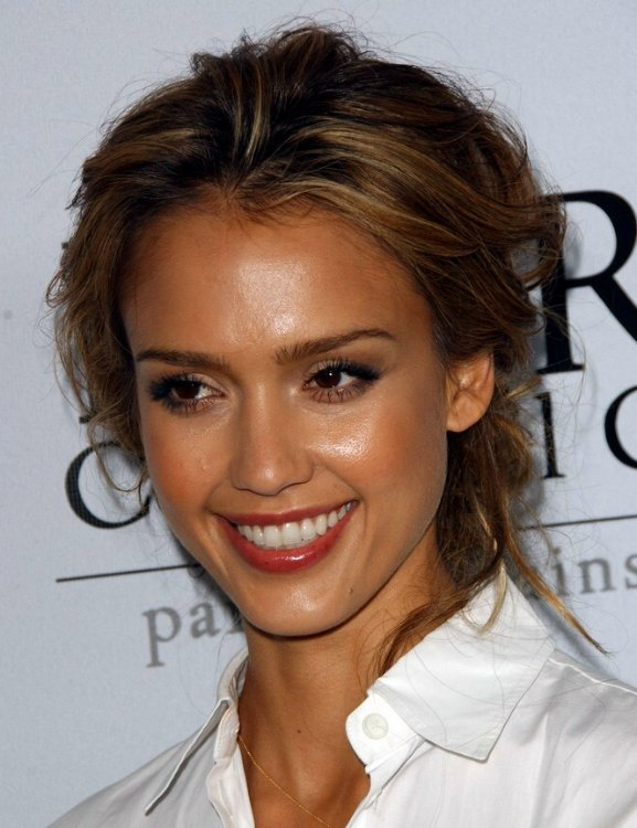Jessica Alba wearing a crisp white shirt with her hair
