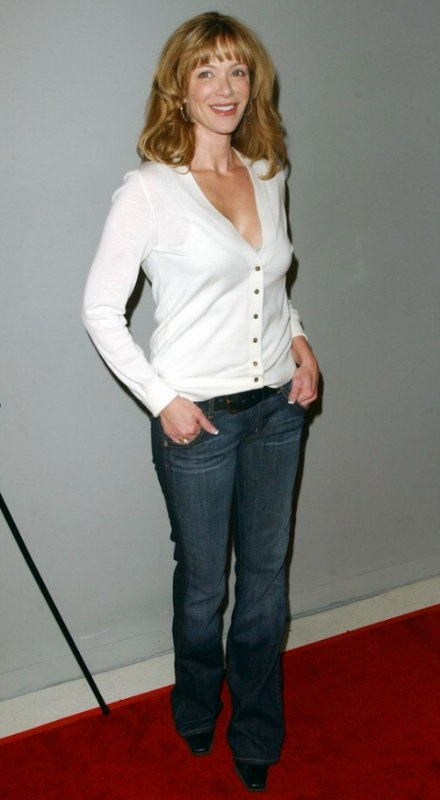 Lauren Holly with long hair styled to keep it bouncy for several hours