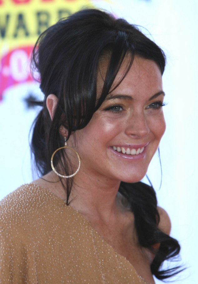 Lindsay Lohan With Dark Brunette Hair Pulled Back In Long