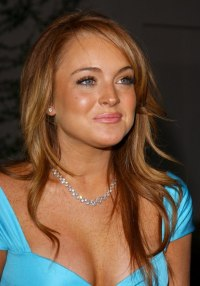 Linday Lohan | dark golden blonde hair with brown stripes
