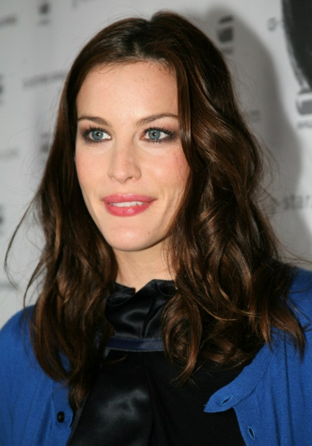 Liv Tyler with her choclocate colored long hair sectioned in the middle