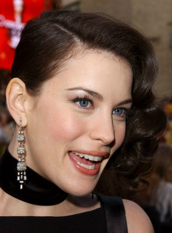 Liv Tyler wearing her hair in a shoulder long bob and showing one of her ears