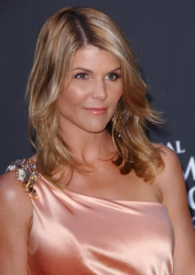 Lori Loughlins windswept hair that nestles closely around
