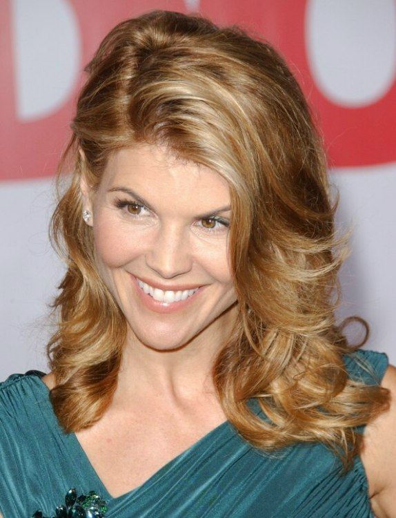 Lori Loughlins Hair With A Wave That Curves Around Her Eye