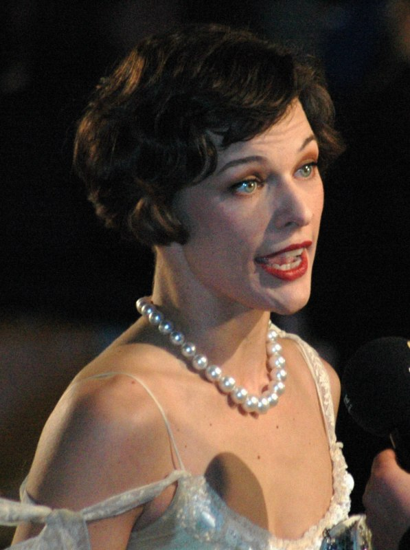 Milla Jovovich Short Hair With Tapered Back And Exposed