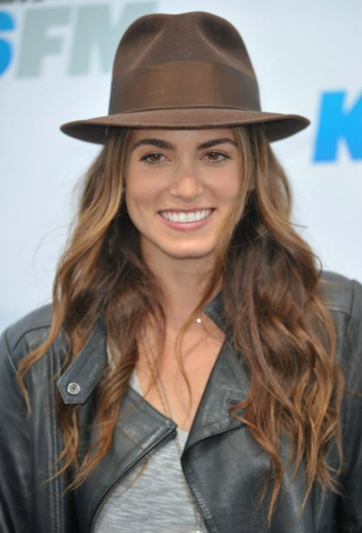 Nikki Reeds hippie look with chest length hair hat and leather jacket