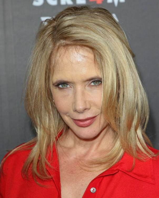 Rosanna Arquette with long hair resting upon her shoulders