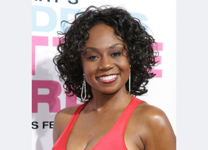 Chantell D Christopher Sporting A Neck Length Curly