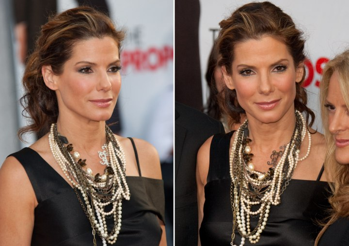 Sandra Bullock Wearing Her Hair Into A Ponytail And Eddie