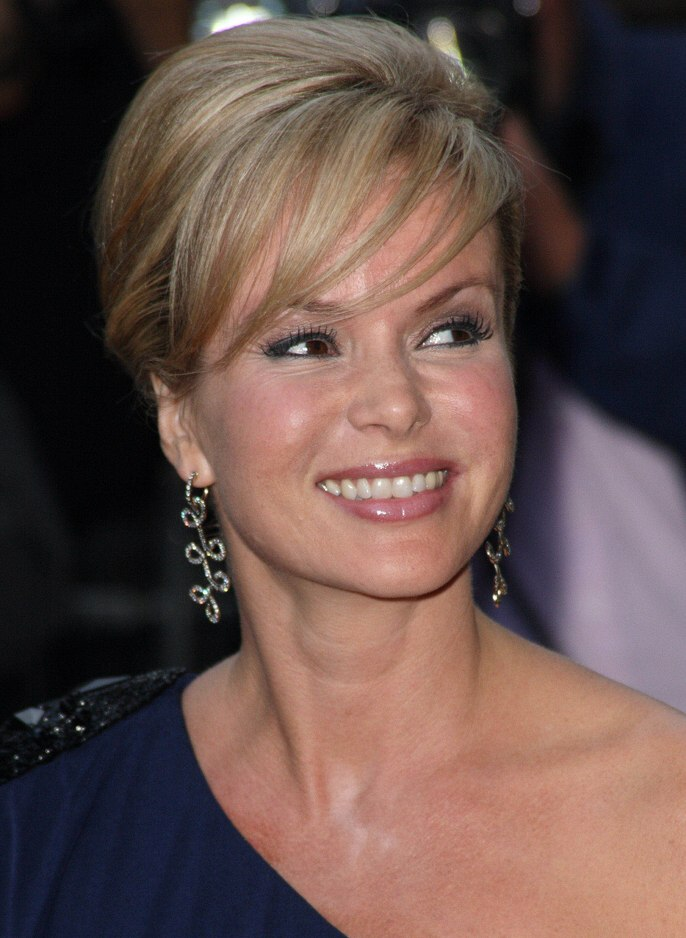 Amanda Holden wearing her hair in a smooth updo  Long earrings increase the length of her neck