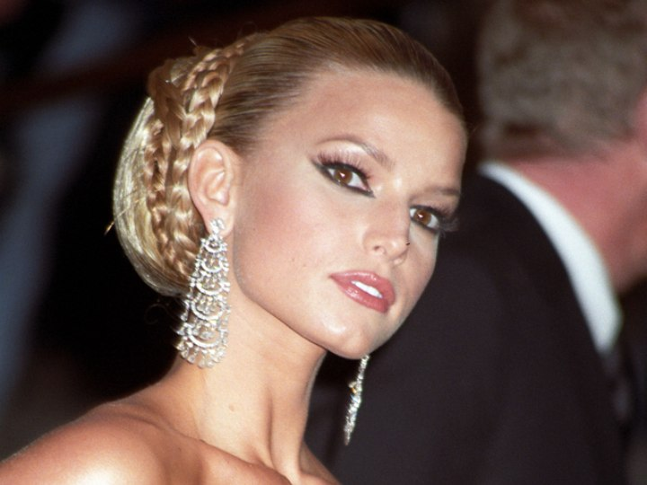 Jessica Simpson wearing her hair pulled back into a bouffant roll updo
