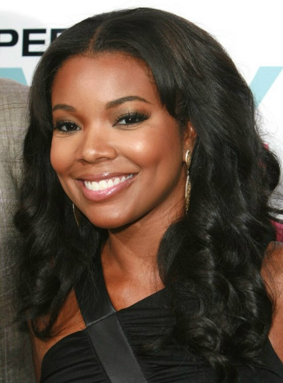 Gabrielle Union  Long layered black hair with curls and parted in the center