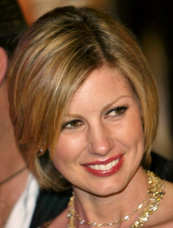 Faith Hill  Clean and conservative bob hairstyle with tapered sides and layers
